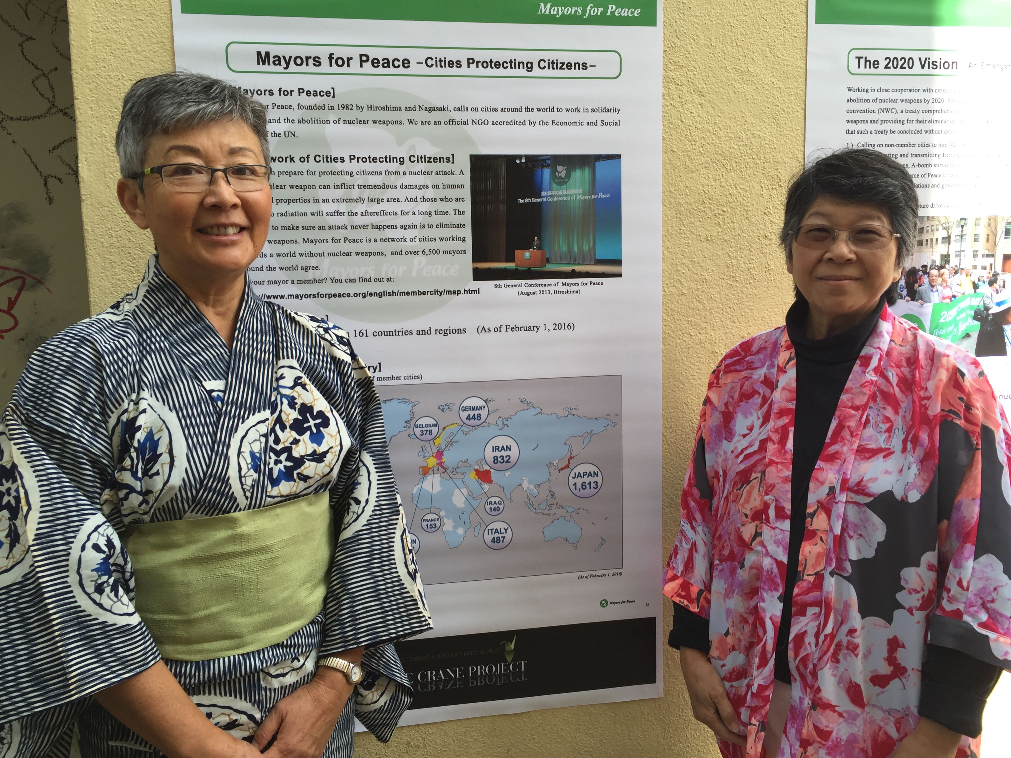 Sachiko Knappman and Phyllis Tajii in front of the Mayors for Peace Exhibit from Hiroshima